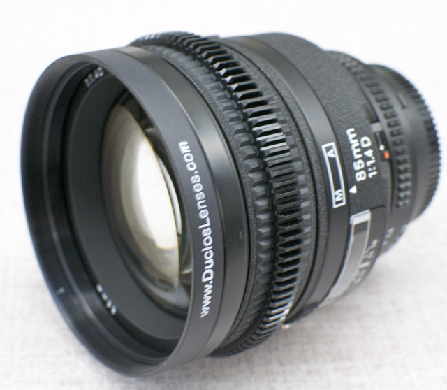 Nikon 85mm f/1.4 modified with focus gear for a follow focus and an 80mm front for common motion picture accessories. This particular lens also had it's manual aperture de-clicked for smooth, seamless rotation.