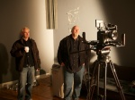 Chris Barrett and Paul Nordin observe lens flare testing upstairs.